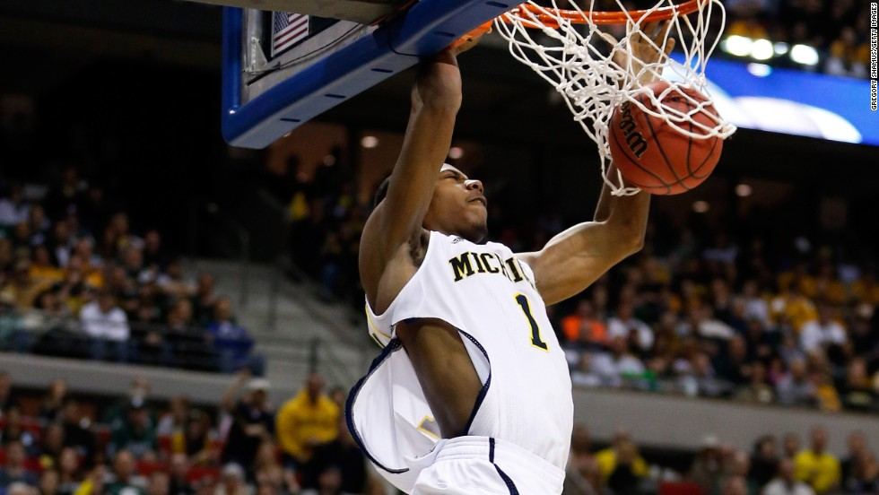 Glenn Robinson III of the Michigan Wolverines dunks against the Virginia Commonwealth Rams on March 23. Robinson's jersey was ripped during play.