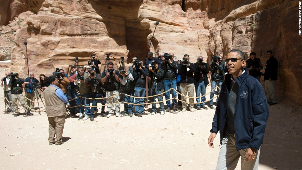 Obama walks past media during his tour of Petra on Saturday.