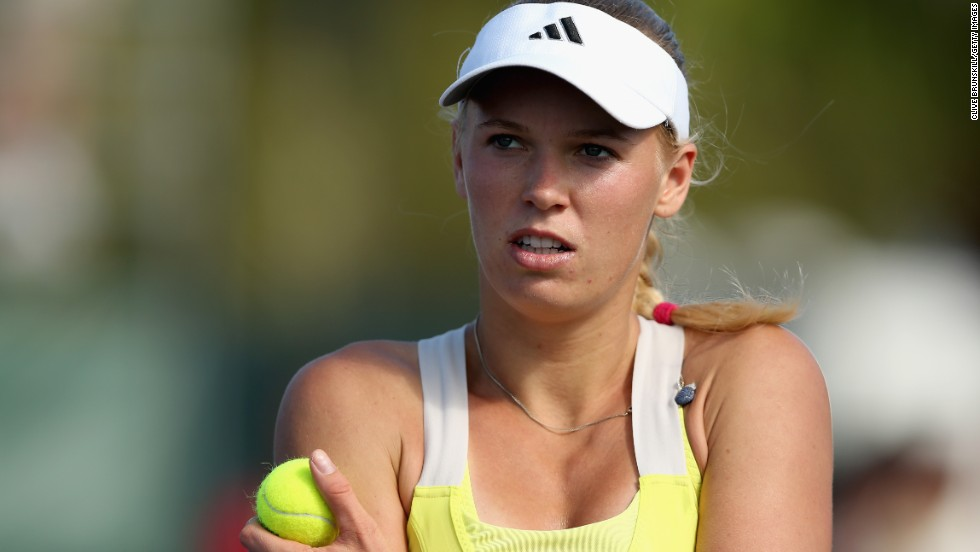World No.9 Caroline Wozniacki suffered a shock defeat by Spain's Garbine Muguruza -- a woman ranked 64 places below the Dane.  Muguruza needed just 81 minutes to claim a 6-2 6-4 win and leave her opponent stunned.