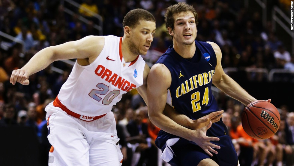 Ricky Kreklow of California, right, drives against Brandon Triche, left, of Syracuse on March 23.