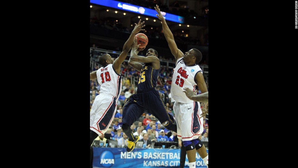 Ramon Galloway of La Salle shoots over against Ladarius White, left, and Reginald Buckner of Ole Miss on March 24.