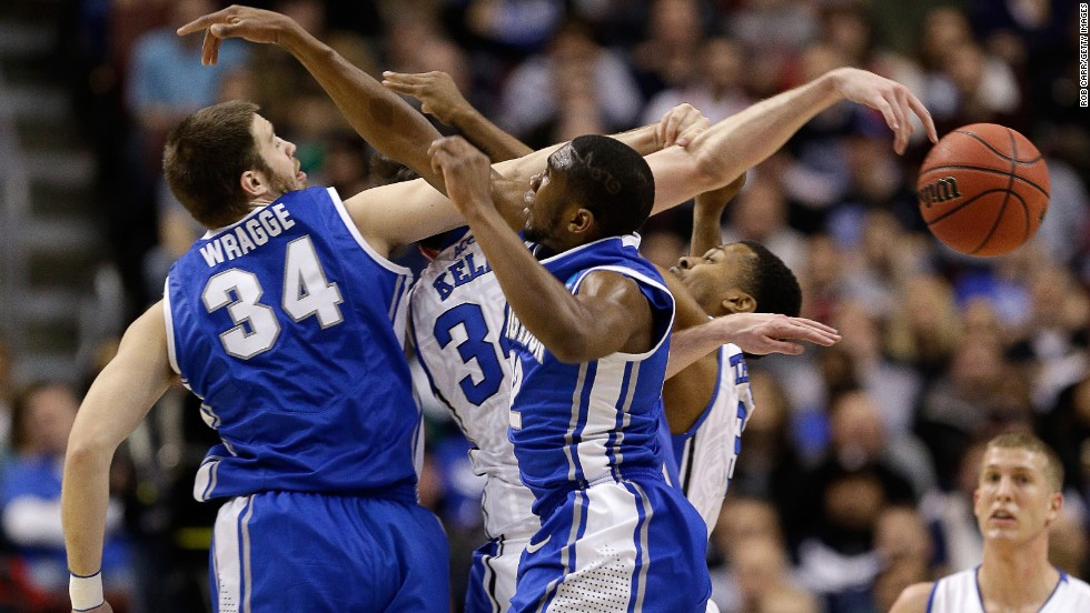 Creighton and Duke players battle for a loose ball in the first half on March 24.