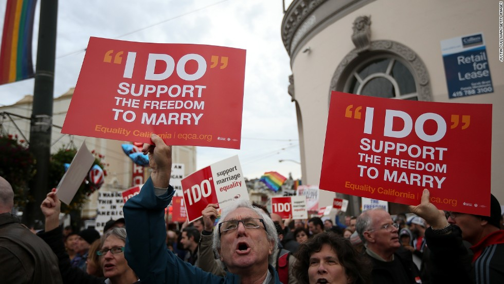 Supporters of same-sex marriage hold signs during a rally in support of marriage equality on March 25 in San Francisco.