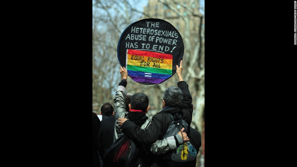 Marriage equality supporters take part in a march in New York on Sunday, March 24.
