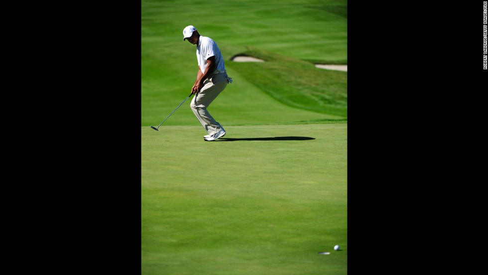 Woods misses a putt at the Frys.com Open in October 2011. That month, he fell out of golf's top 50 for the first time in almost 15 years. Woods reportedly lost millions in endorsements after sponsors ended their ties with him in the wake of his sex scandal.