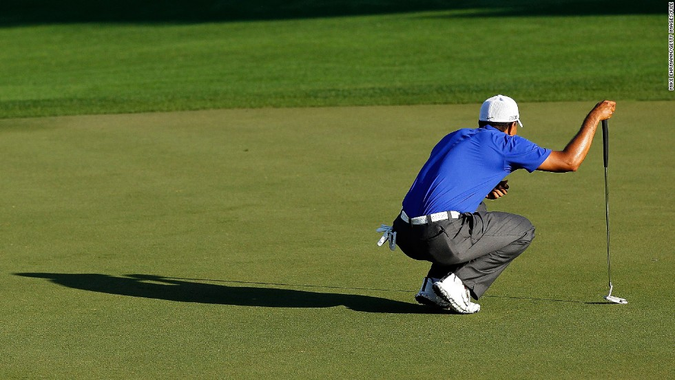 "Woods lines up his putt at the Honda Classic in March 2012. <a href=""http://edition.cnn.com/2012/03/05/sport/golf/golf-mcilroy-augusta-woods"">He shot a 62, his lowest final round as a professional</a>, but he tied for second in the PGA Tour event."