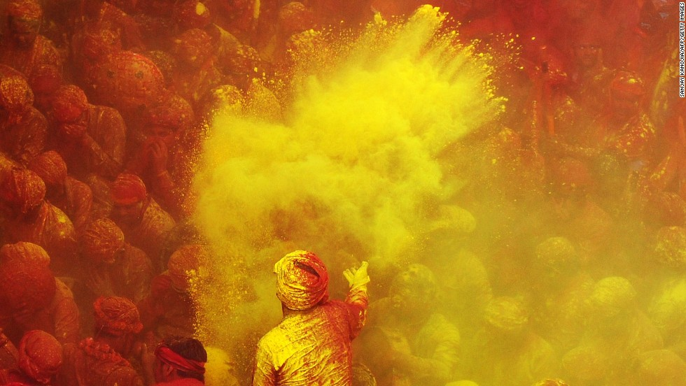 Devotees brace for another barrage of colored powder at the Radha Rani temple in Barsana, India, on Thursday, March 21.