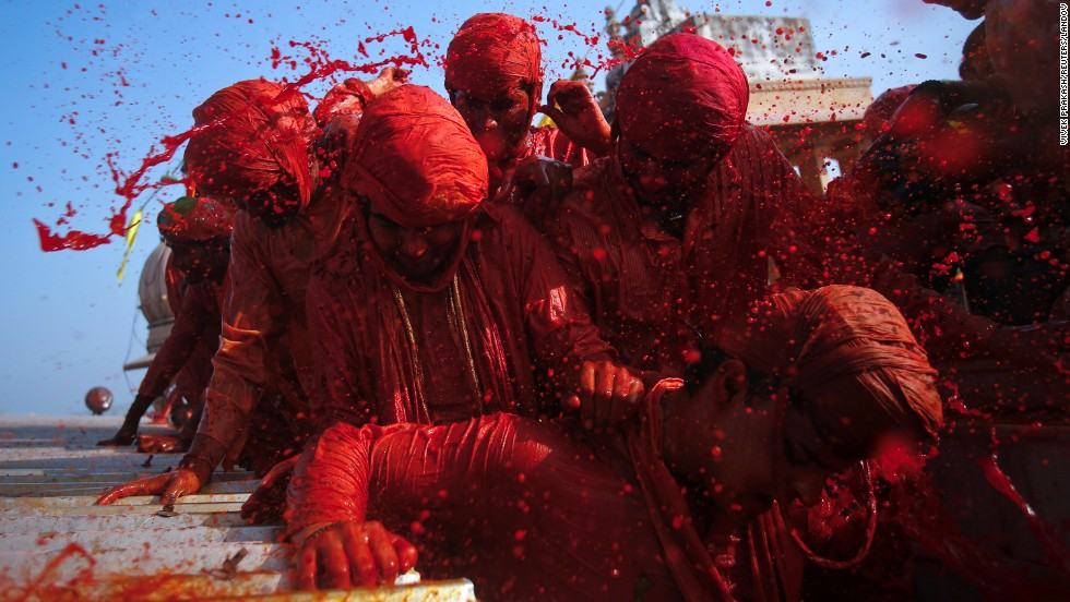 Devotees throw colored water at each other at a temple in Barsana on March 21.