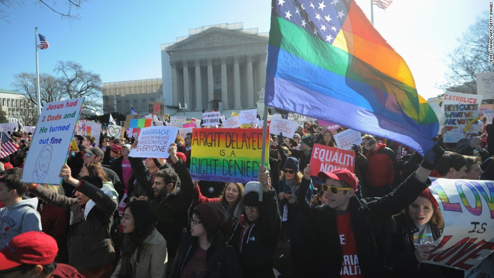 Same-sex marriage supporters shout slogans in front of the U.S. Supreme Court on Tuesday.