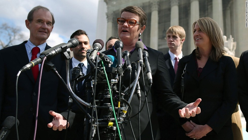 Plaintiffs Kris Perry, center, and Sandy Stier, right, talk to the media with attorney David Boies, left, after arguments Tuesday at the Supreme Court.