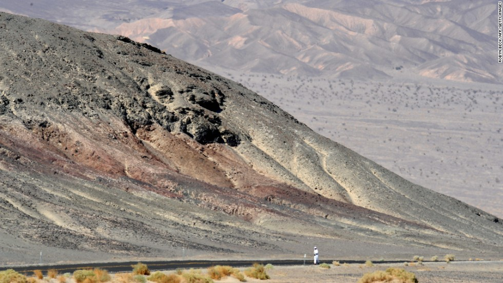 An ultra-marathoner treks through the unforgiving landscape of Death Valley, California, where the high temperature topped 100 degrees for 154 straight days in summer 2001.