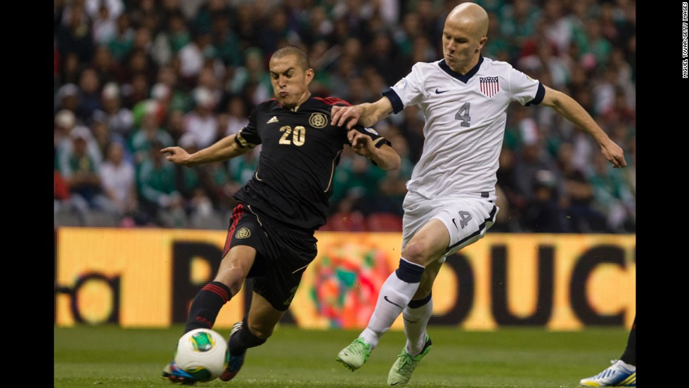 Jorge Torres of Mexico and Michael Bradley of the U.S. struggle for control of the ball.