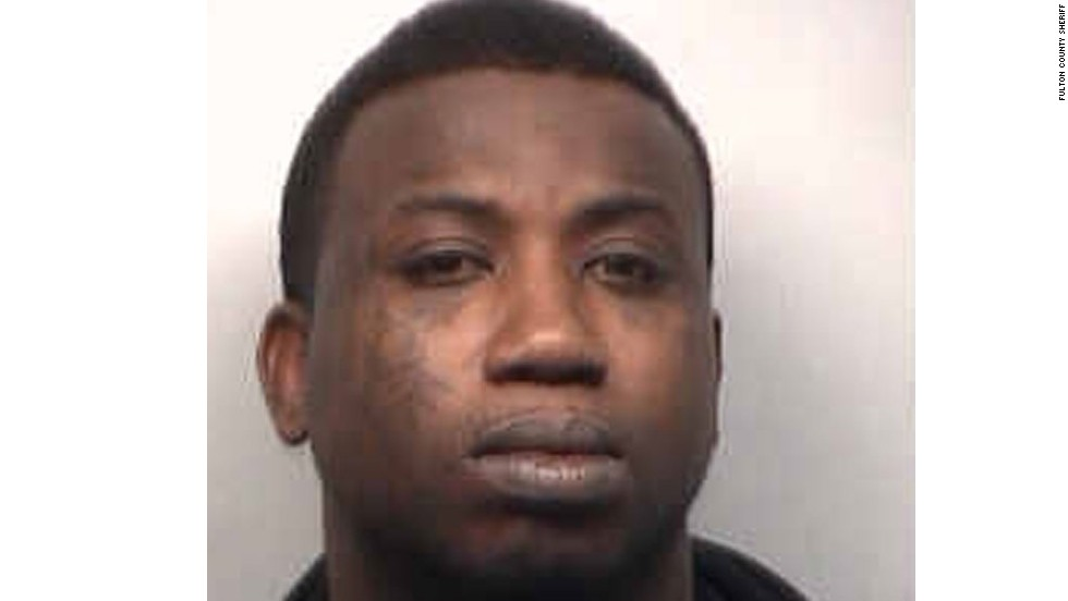 "<a href=""http://www.cnn.com/2013/03/27/showbiz/music/gucci-mane-arrested/index.html"">Rapper Gucci Mane</a> turned himself in to authorities in March 2013 after a warrant was issued for his arrest on aggravated assault charges in Atlanta. In August, he was sentenced to three years and three months in federal prison on firearm charges."