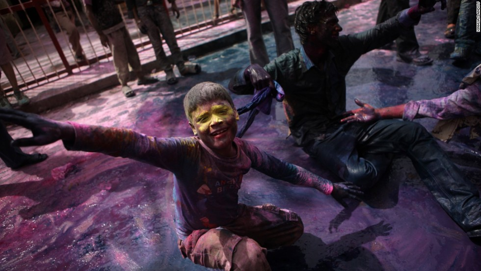 People celebrate Holi in Mathura, India, on March 27.
