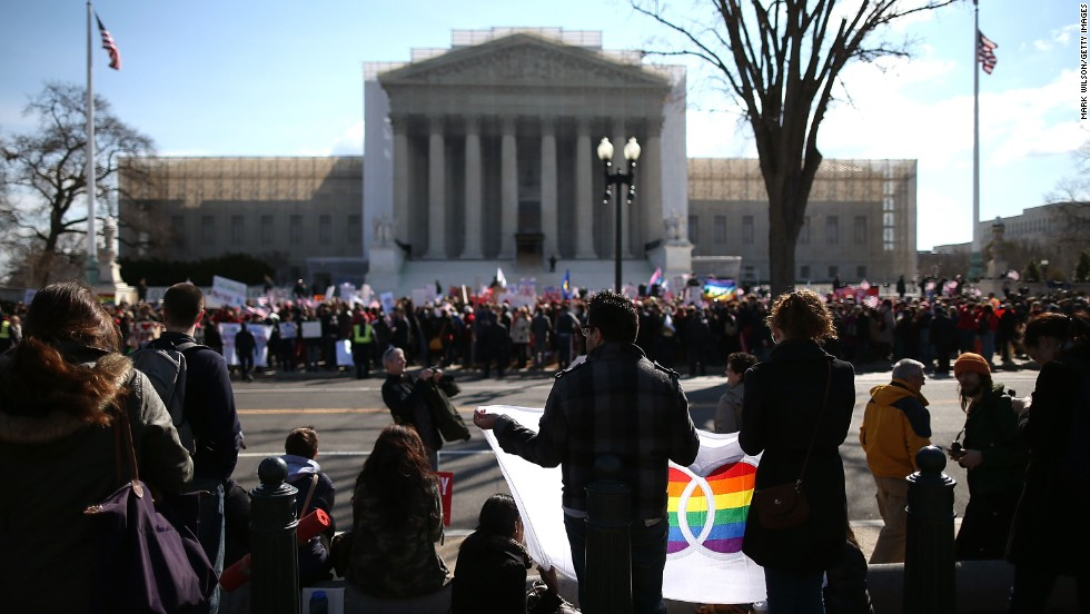 Demonstrators from both sides of the same-sex marriage debate gather in front of the U.S. Supreme Court on Wednesday.