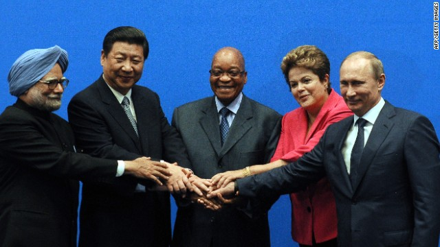 BRICS leaders (From L) India Prime minister Manmohan Singh, President of the People's Republic of China Xi Jinping, South Africa's President Jacob Zuma, Brazil's President Dilma Rousseff and Russian Federation President Vladimir Putin, pose for a family photo in Durban.