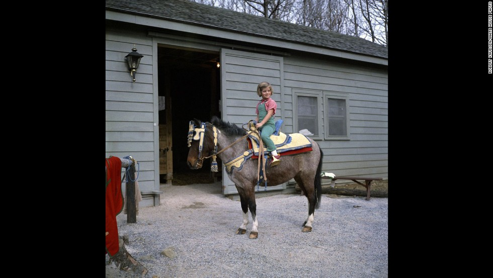Caroline sits astride Macaroni during the weekend trip to Camp David, located in Frederick County, Maryland.