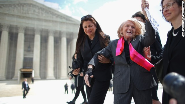 Edith Windsor, in a pink scarf, acknowledges her supporters as she leaves the Supreme Court on March 27 after arguments in her case challenging the constitutionality of the Defense of Marriage Act.