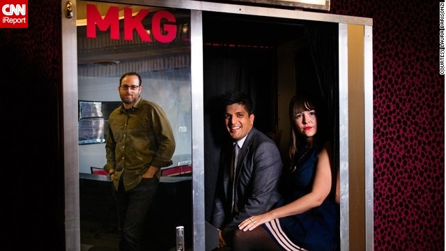 At marketing agency MKG, employees squeeze into their in-office photo booth.