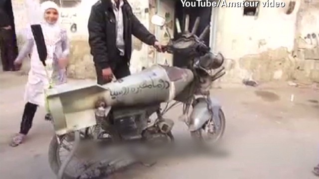 Syrians use humor, weapons to survive