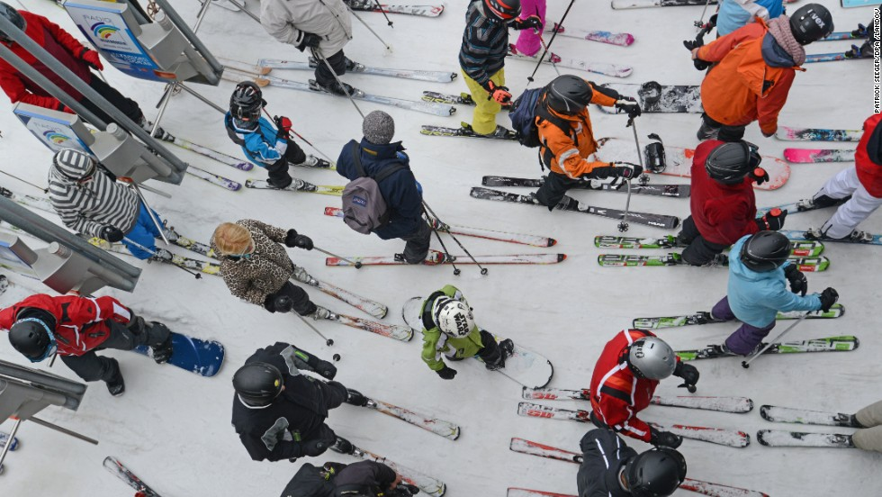 Snowboarders and skiers wait to take a ski lift at Feldberg Mountain in Schwarzwald, Germany, on Friday, March 29.