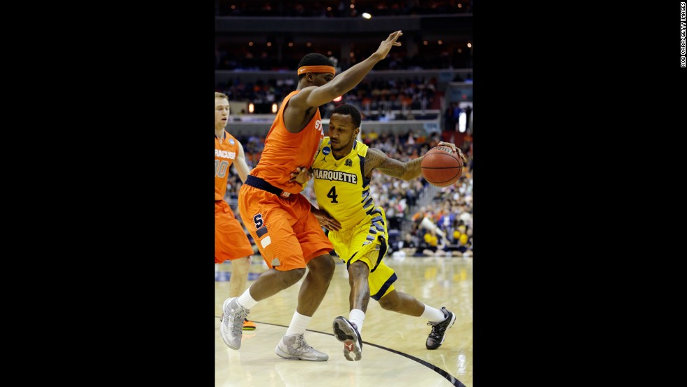Todd Mayo of Marquette handles the ball against C.J. Fair of Syracuse on March 30.