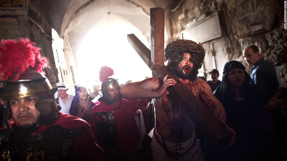 An American pilgrim from the Hope of Glory order re-enacts the passion of Christ during the Good Friday procession along the Via Dolorosa in Jerusalem.