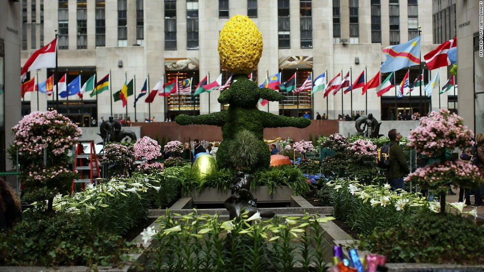 A 12-foot Easter Bunny topiary stands among white Easter lilies in New York's Rockefeller Center on Thursday.