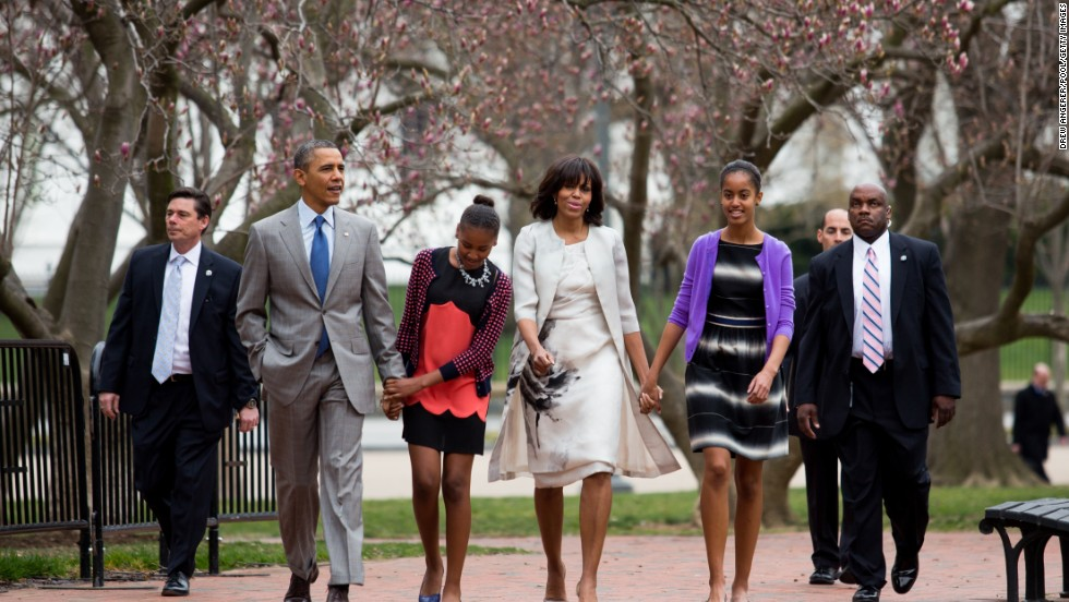President Barack Obama, daughter Sasha, first lady Michelle Obama and daughter Malia walk across Lafayette Park from the White House on their way to Easter services at St. John's Episcopal Church on Sunday in Washington on March 31.