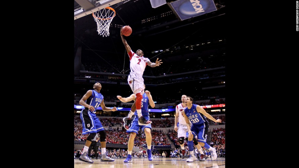 Russ Smith of Louisville drives for a shot attempt.