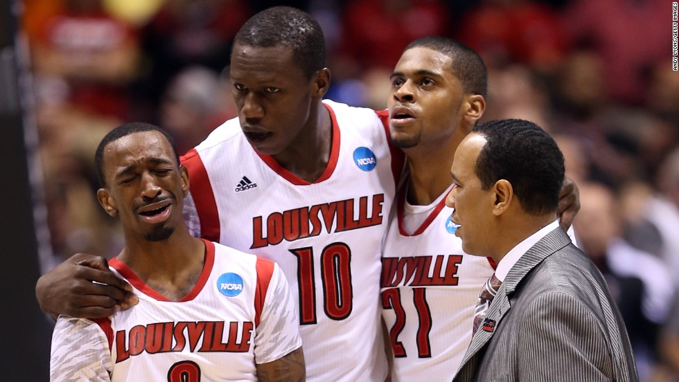 From left, Russ Smith, Gorgui Dieng, Chane Behanan and assistant coach Kevin Keatts of the Cardinals react after Ware's injury.