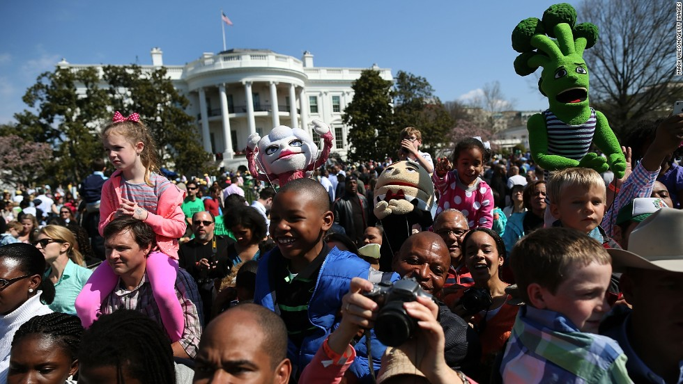 People watch as President Obama reads a book to children during the event.
