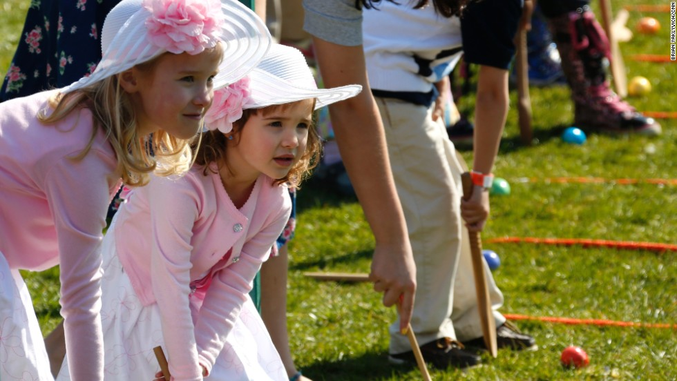 Two girls look at their competitors in the race.