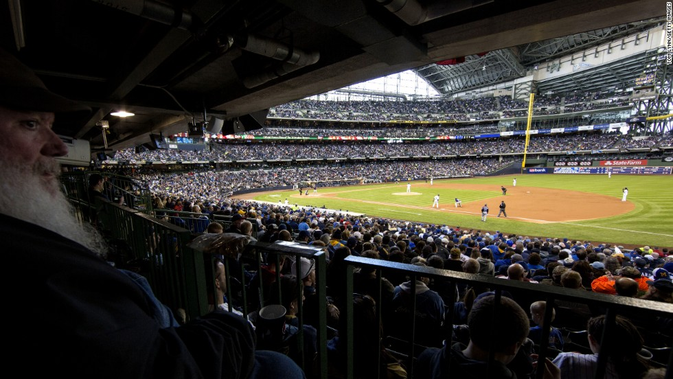Fans watch the Colorado Rockies take on the Milwaukee Brewers on Opening Day in Milwaukee. The Brewers defeated the Rockies 5-4.