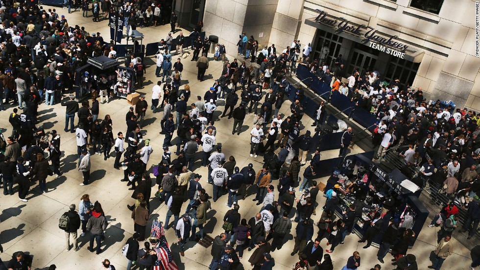 Fans enter Yankee Stadium on April 1 for the game against the Red Sox.