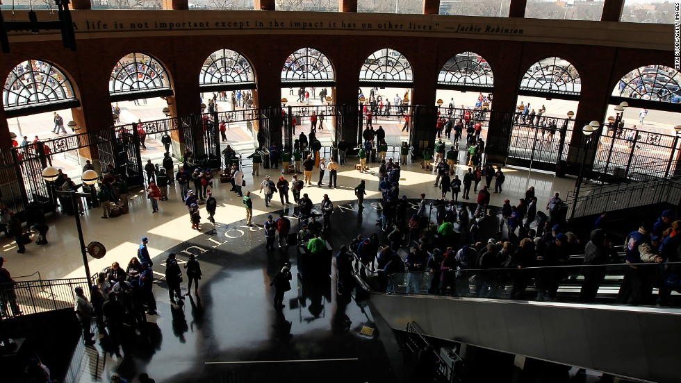 Fans enter the Jackie Robinson rotunda before the game between the New York Mets and the San Diego Padres.
