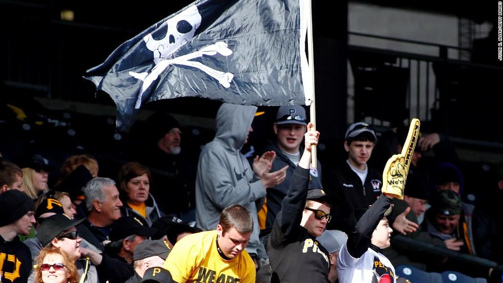 Pirates fans cheer during the game against the Cubs.