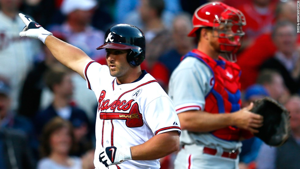 Dan Uggla of the Atlanta Braves reacts after a solo home run against the Philadelphia Phillies.