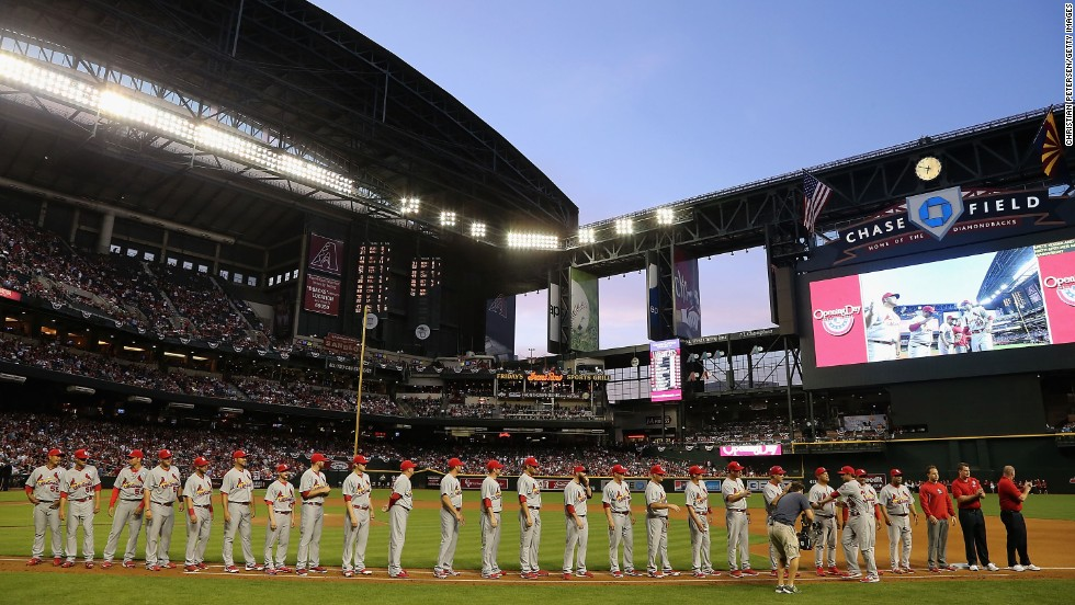 The St. Louis Cardinals line up for introductions before their game against the Arizona Diamondbacks at Chase Field in Phoenix. The Diamondbacks won 6-2.