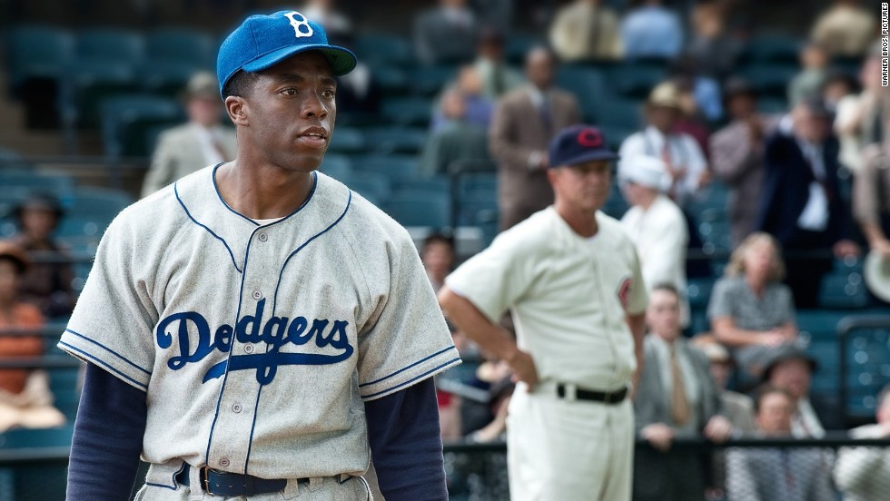 "Chadwick Boseman stars as Jackie Robinson, the first African-American to play for a Major League Baseball team, in Brian Helgeland's ""42."" Harrison Ford plays Branch Rickey, the Brooklyn Dodgers' general manager who made history signing Robinson, in the biographical film."