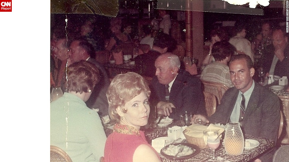 "<a href=""http://ireport.cnn.com/docs/DOC-948004"">Teri Coley Adams' parents</a> enjoy an evening in Oahu, Hawaii, in 1969. Her dad is wearing a thin striped tie and a sports jacket. Her mom has on a red linen dress with a matching satin red peacock scarf. ""As I recall, the dress was pretty short, well above Mom's knees, but she had the legs for it,"" Adams says."