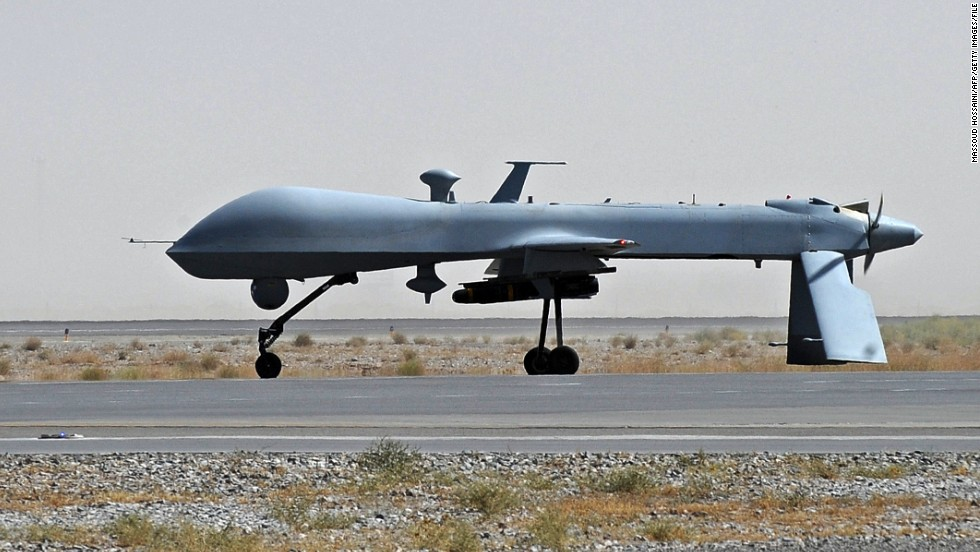 A US Predator Unmanned Drone Armed With Missile On The Tarmac At Kandahar Military Airport