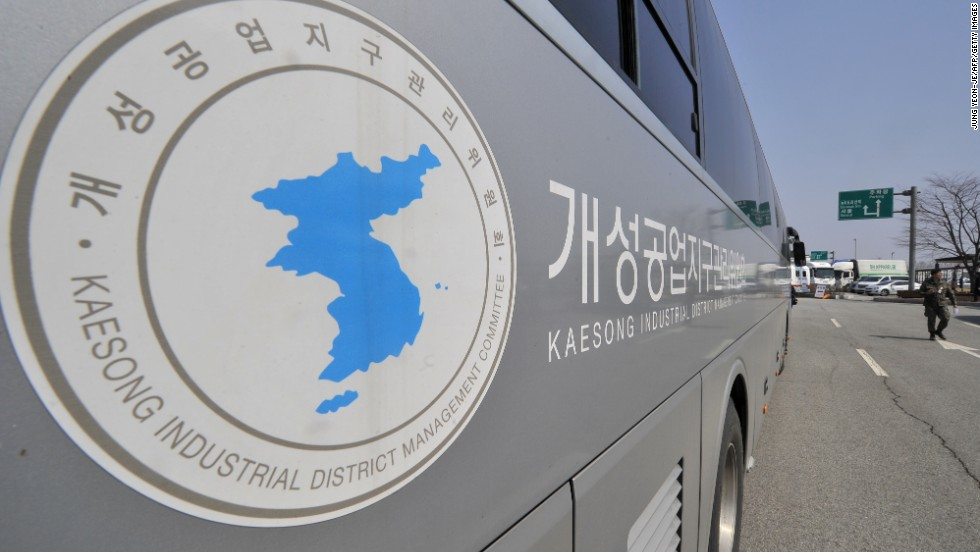 A South Korean soldier walks past a Kaesong Industrial District Management Committee bus at the Inter-Korean Transit Office in April.