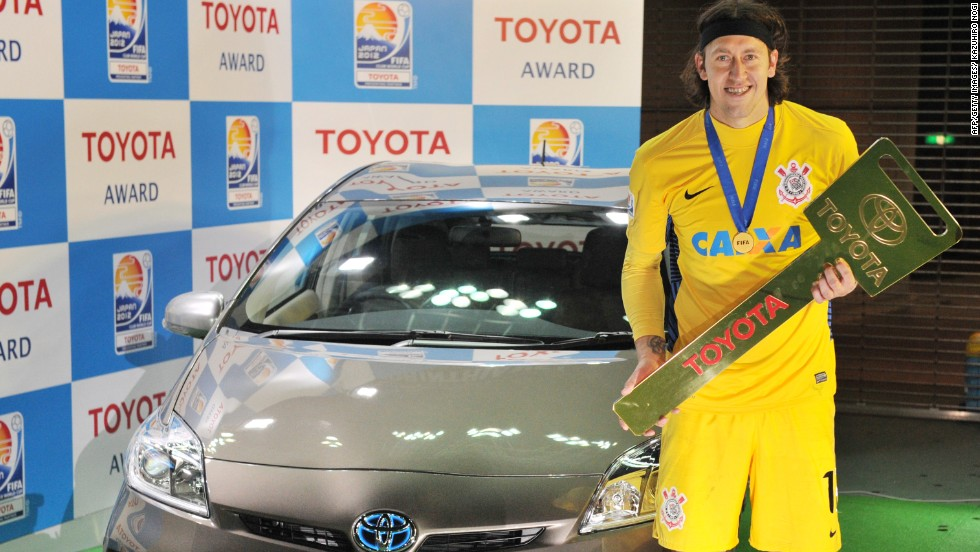 Corinthians goalkeeper Cassio poses besides a Toyota Prius vehicle after he won the Most Valuable Player (MVP) prize during the awards ceremony of the Football Club World Cup in Yokohama.