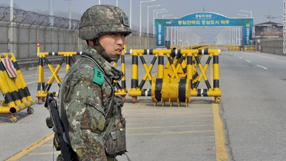 A South Korean soldier stands on a road linked to North Korea at a military checkpoint in Paju on Wednesday, April 3. North Korea has asked for talks to reopen the industrial complex, which is an important symbol of cooperation between the two countries.