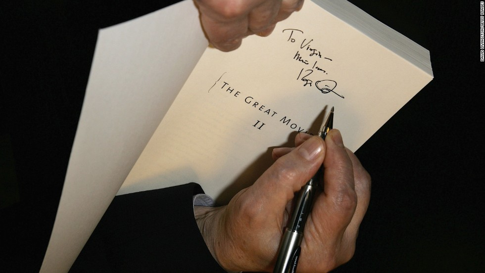 "Ebert signs his book ""Great Movies II"" in 2006 in Santa Monica, California."