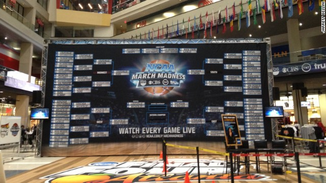 A giant March Madness bracket lives in the CNN Center atrium to remind visitors that they've absolutely lost their office pool.