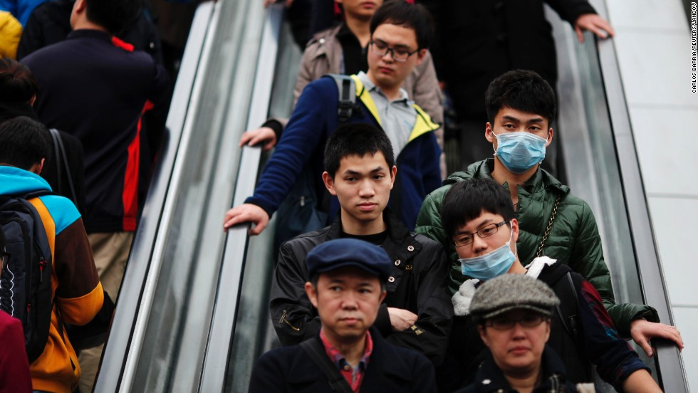 Men wear face masks at a shopping mall in downtown Shanghai on April 5.