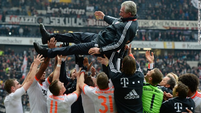 Jupp Heynckes is lifted in the air by his Bayern Munich players after becoming the oldest coach to win the Bundesliga title.