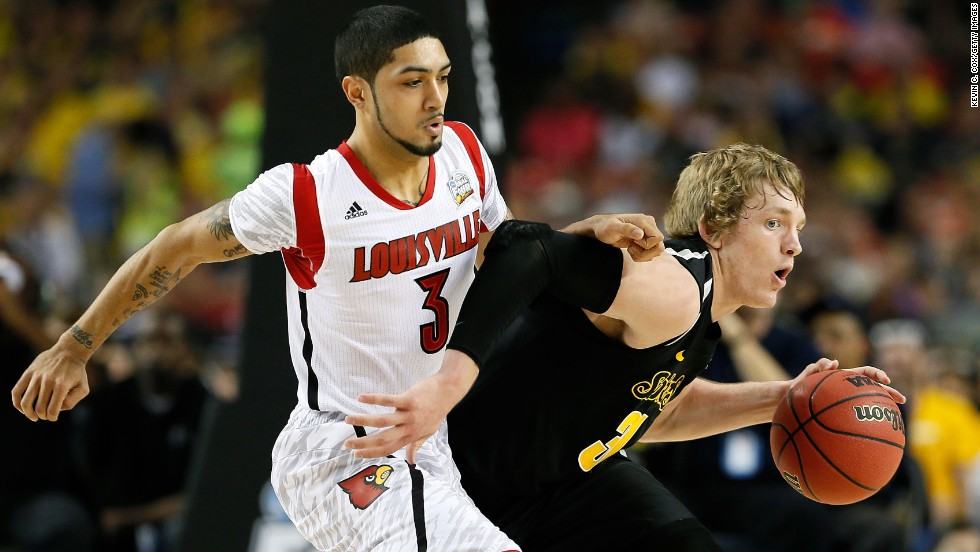 Ron Baker of the Wichita State Shockers moves the ball against Peyton Siva of the Louisville Cardinals.